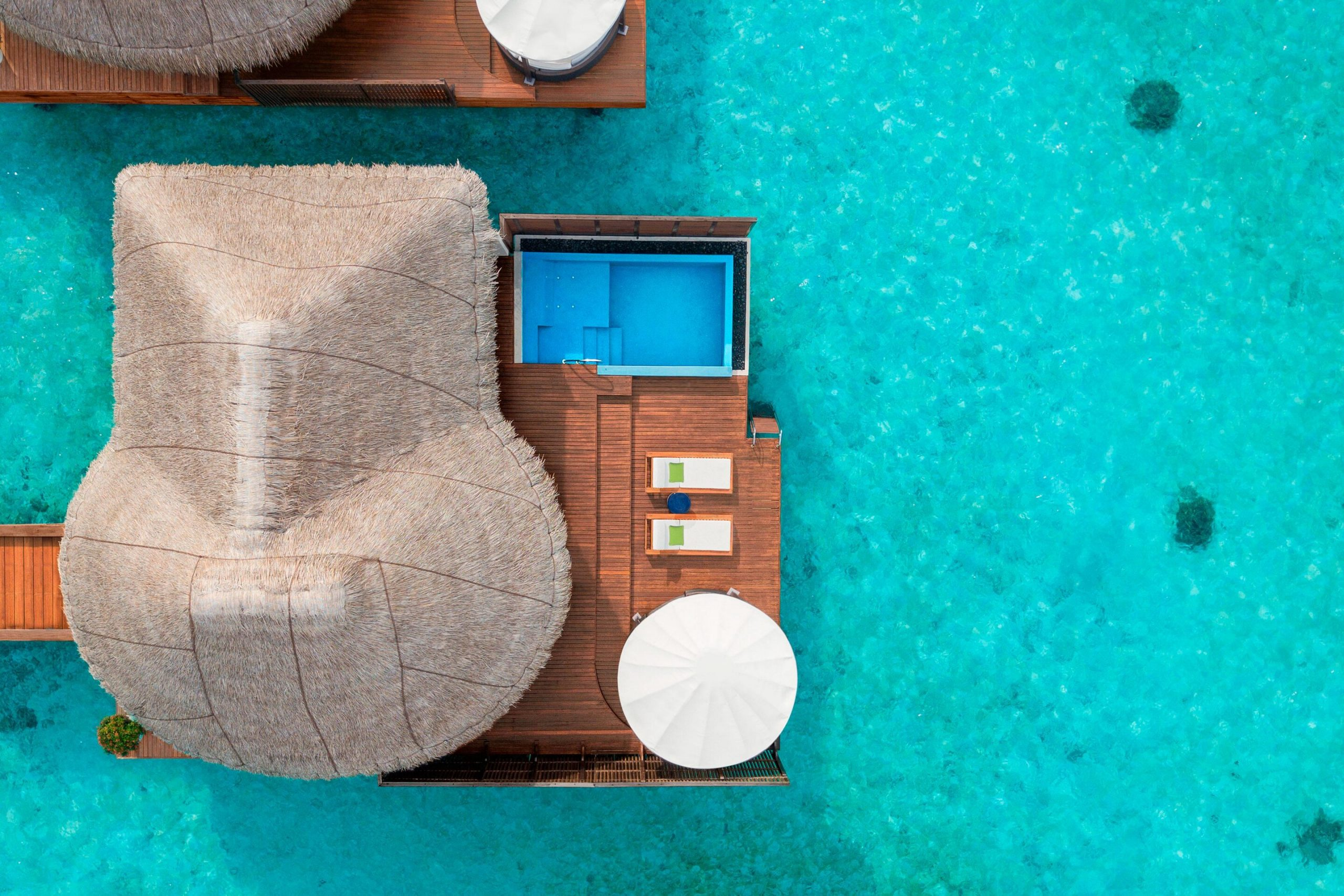 mlewh-overwater-guestroom-7671-hor-clsc
